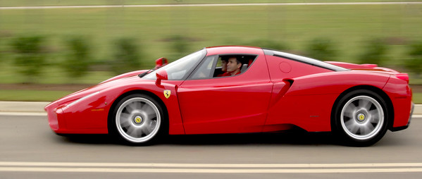 Wade Williams with Ferrari of Atlanta takes the Ferrari Enzo for a spin in the parking lot of The Renaissance in Ridgeland Friday. The Enzo will be one of four Ferraris along with over 60 other european cars and motorcycles n display Saturday at the Classic European Auto and Motorcycle Show at The Renaissance.