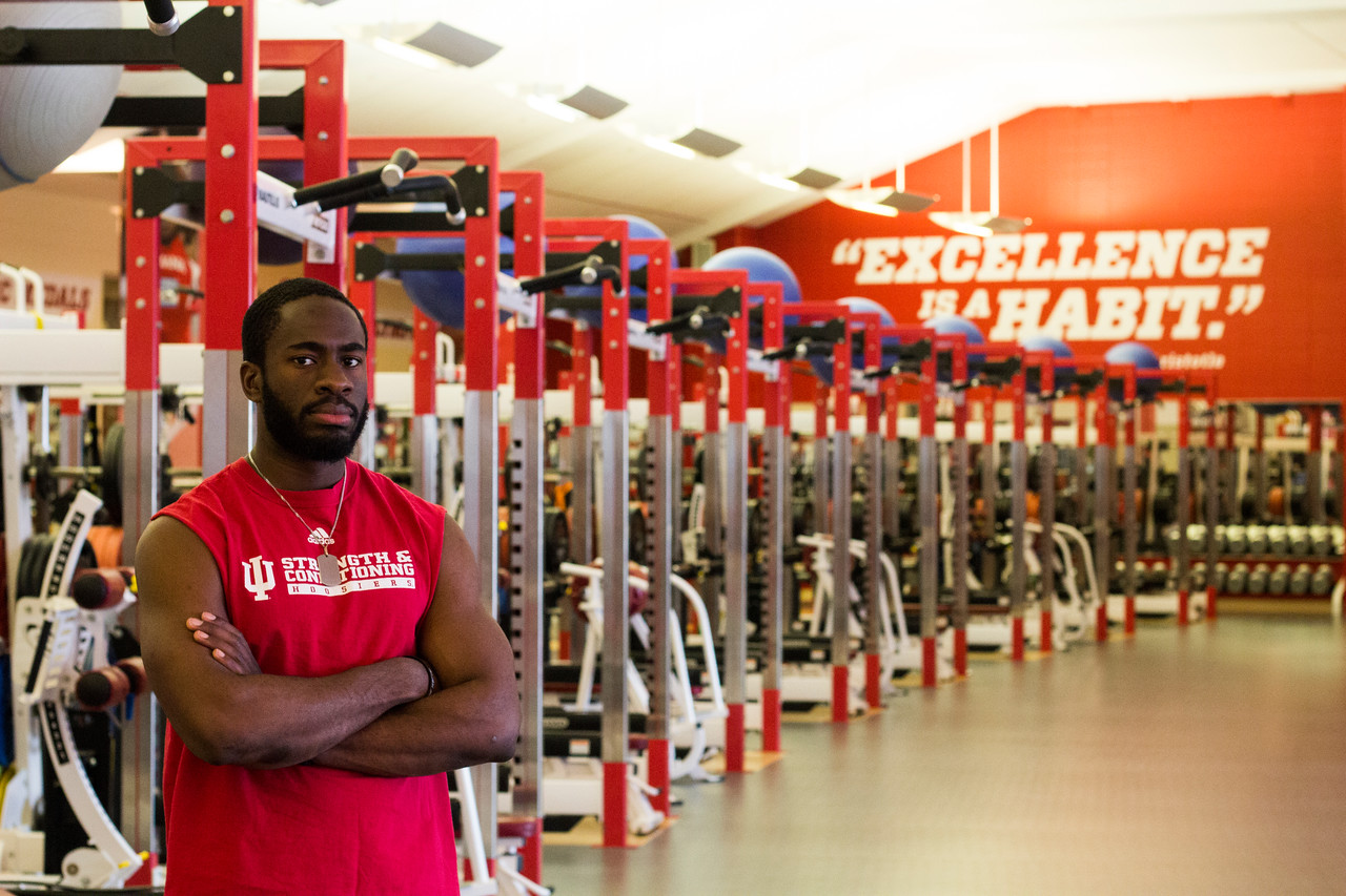 Will Alli, IU strength coach, poses with the free-weight racks at IU Memorial Stadium