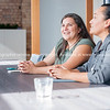 Two Maori women on one side of table in business meeting