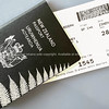 New Zealand passport and airline ticket
