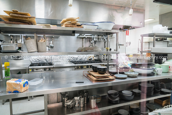 Behind the scenes, restaurant kitchen benches and equipment.