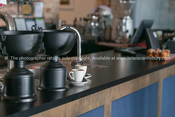Equipment and cups on a modern cafe bar.