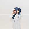 Muslim woman in hijab and white top