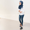 Muslim woman in hijab white top and jeans