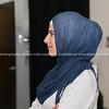 Profile portrait middle eastern woman in blue hijab