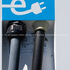 Symbol of electric car public recharge station graphic white electric cable and plug closeup