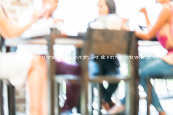 Sitting around cafe table - defocused.
