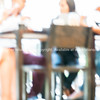 Sitting around cafe table - defocused.