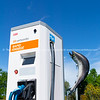 electric car public recharge station in town by leaping salmon iconic entrance.