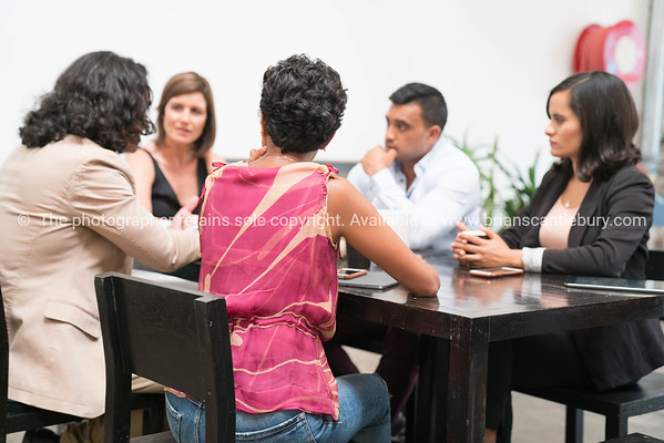 Business meeting with co-workers of mixed race and sex work to reach a decision.
