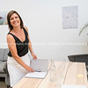Business woman ialone in meeting room closes book