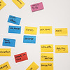 Business planning notes on colored sticky notes