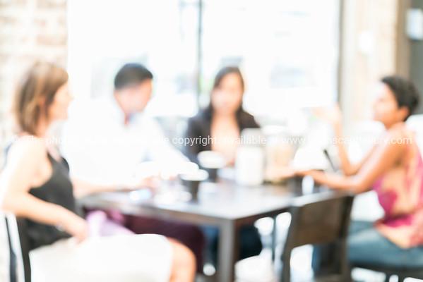 Defocused background image four people in cafe meeting