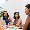 Group women around business table in discussion