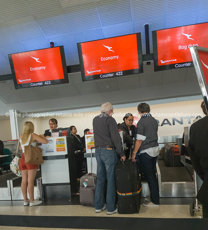 People checking in and getting seat allocation at Quantas counter
