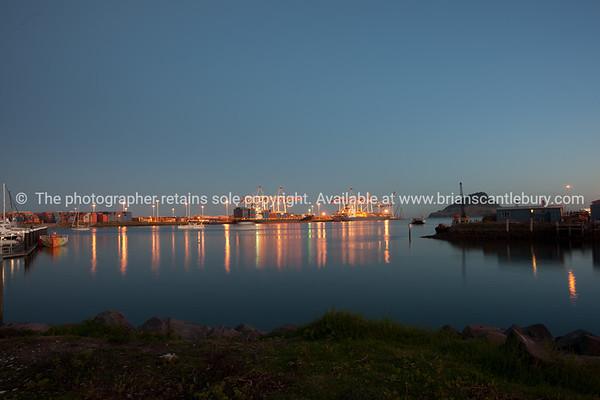 "Tauranga photo; Port of Tauranga across harbour before sunrise. See;  <a href=""http://www.blurb.com/b/3811392-tauranga"">http://www.blurb.com/b/3811392-tauranga</a> mount maunganui landscape photography, Tauranga Photos;"
