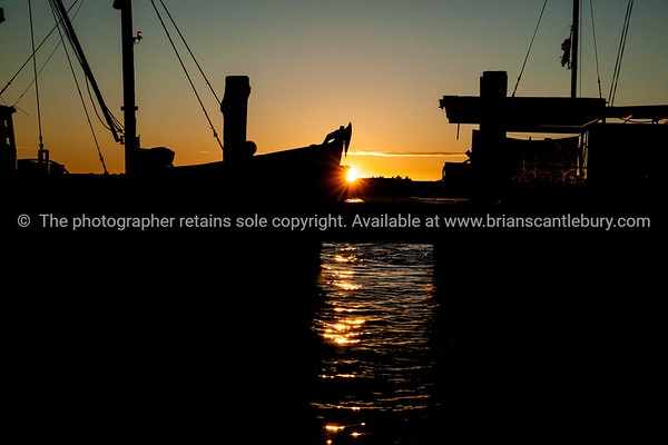 "Tauranga Harbour, Fishermans Wharf, silhouettes at sunrise. See;  <a href=""http://www.blurb.com/b/3811392-tauranga"">http://www.blurb.com/b/3811392-tauranga</a> mount maunganui landscape photography, Tauranga Photos;"