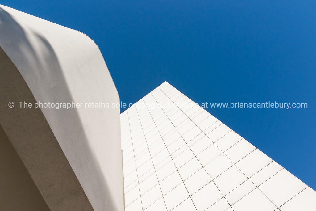 White on blue wall against sky from low point of view.