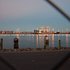 """Tauranga photo; Port of Tauranga just before sunrise, red sky and container terminal lights through fence. See;  <a href=""""http://www.blurb.com/b/3811392-tauranga"""">http://www.blurb.com/b/3811392-tauranga</a> mount maunganui landscape photography, Tauranga Photos;"""