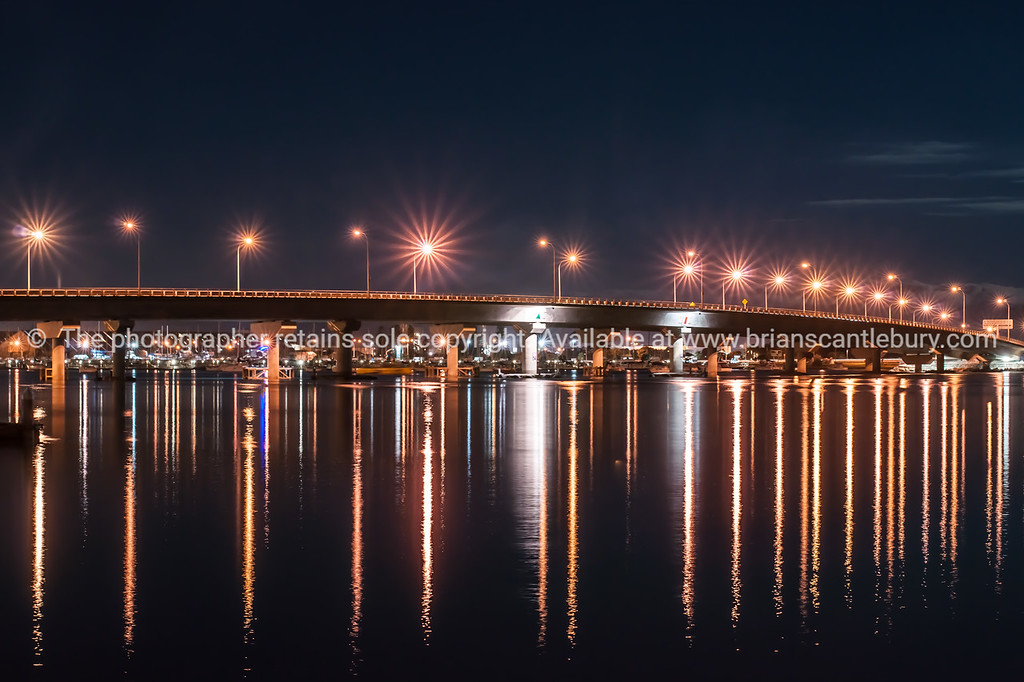 "Tauranga Harbour Bridge under night sky.<br /> Lights reflected in the calm harbour water. See;  <a href=""http://www.blurb.com/b/3811392-tauranga"">http://www.blurb.com/b/3811392-tauranga</a> mount maunganui landscape photography, Tauranga Photos;"