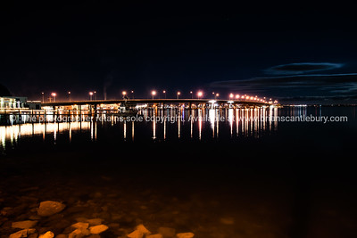 Tauranga Harbour Bridge under night sky. Lights reflected in the calm harbour water. See; www.blurb.com/b/3811392-tauranga mount maunganui landscape photography, Tauranga Photos;