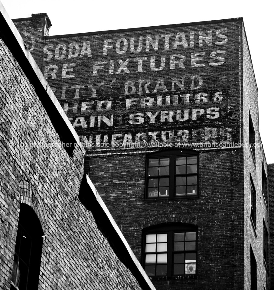Brick building and old sign, architectural stock image in black and white. Seattle, USA.<br /> <br /> Fine art photography, imagine this image on your wall.