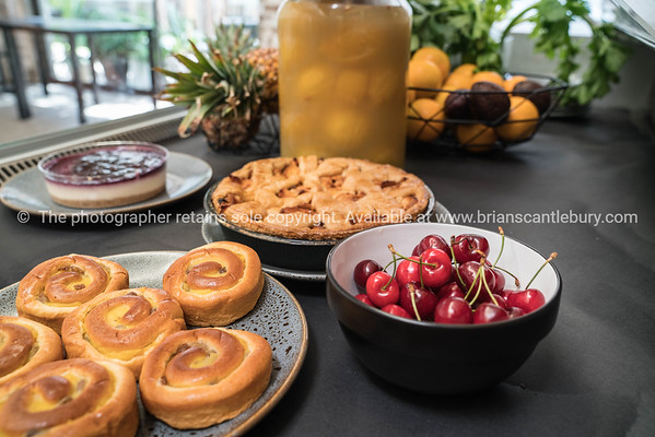 Cherries, pastries and counter food in cafe counter food in chiller cabinet.
