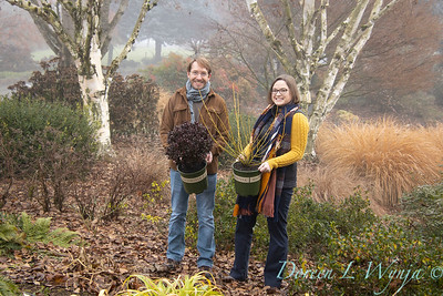 Justin & Megan with red and gold plant pick_1112