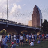 Tourists observing 1.5 million free-tailed bats emerge from the Congress Avenue Bridge in Austin, Texas. Emergences