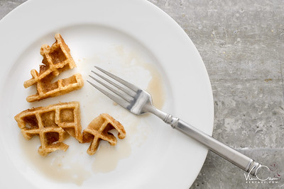 Plate of waffles mostly eaten