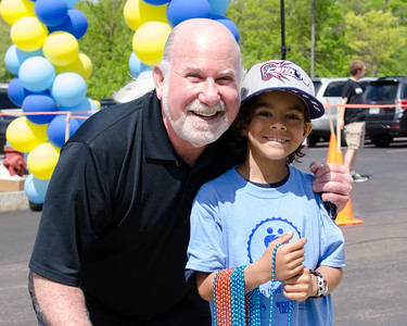 Eliot Tatelman, President & CEO of Jordan's Furniture, and participant. Massachusetts Resource Exchange (M.A.R.E), Walk for Adoption