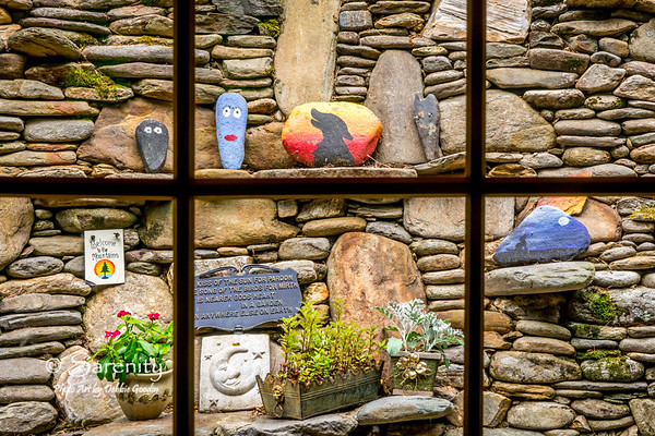 The view from the kitchen window!  A rock wall designed by Dale Campbell, one of the owners!  Complete with rocks painted by young guests to the cabin!