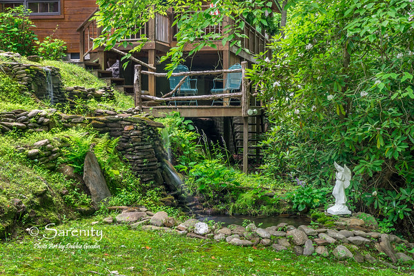 A 3-tiered, ever-flowing river rock waterfall is just outside the front door!