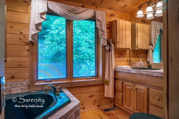 A jacuzzi tub overlooking a 7-acre Frasier Fir Christmas Tree Forest!