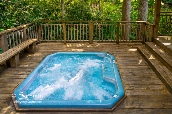 A sunken hot tub, between the side rocking porch and firepit is relaxing and fun!