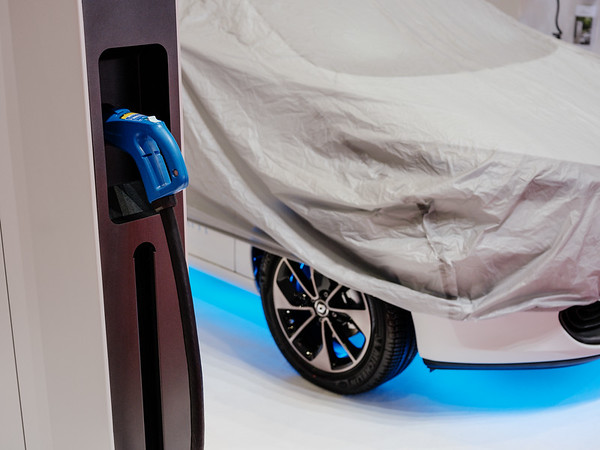 Electric charger and car under wrap at Energie360° booth - Samuel Zeller for the New York Times