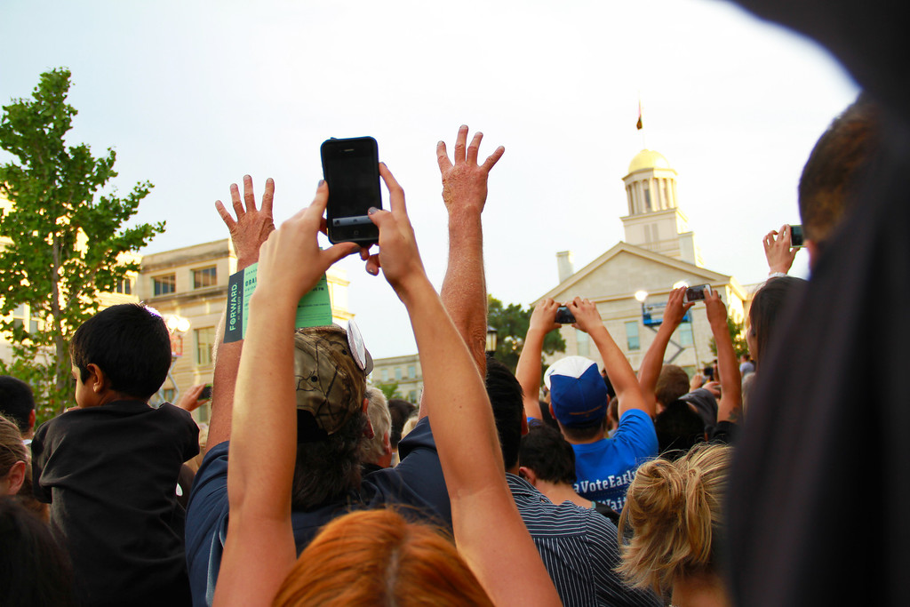 Iowa City, IA-The audience cheer and take photos during President Obama's speech on the Pentacrest on Friday, September 7, 2012.