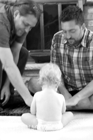 Uncle Dave and Daddy Bryan teaching Jack how to use the iphone..OH no I have that  wrong...Jack is teaching the older boys how its done!!