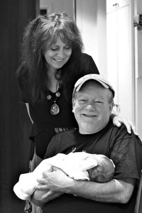 One Day Old Jack Everett Pynn with proud grandparents Jon and Sandra...baby Jack is requesting Grandpa Steve to get his  butt out here so he can have his photo with baby too!!  Fathers Day 2012
