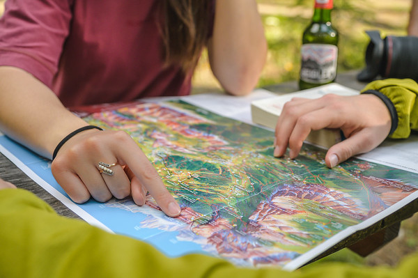 Camping Sass Dlacia - couple exploring the local map in the camping  // Outdoor, lifestyle photography