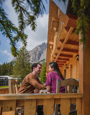 Camping Sass Dlacia - porch of the wooden lodge  // Outdoor, lifestyle photography