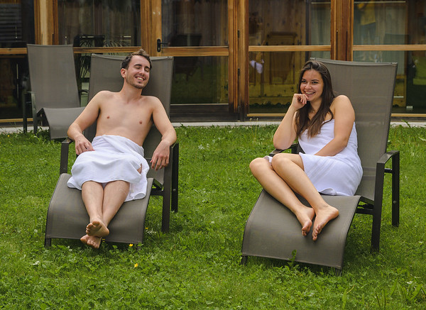 Camping Sass Dlacia - couple in the outdoor sunbeds, wellness area  // Wellness, lifestyle photography