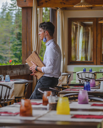 Camping Sass Dlacia - waiter during a small break, enjoying the outside view  // Interiors, staff photography