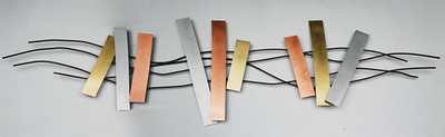 Ten foot wide wall sculpture with steel, brass, aluminum, and copper