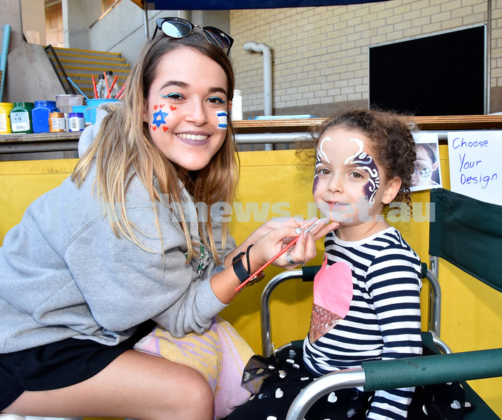 Communal Yom Haatzmaut function at Moriah College. Ella Shul paints Madison Levitt's face. Pic Noel Kessel