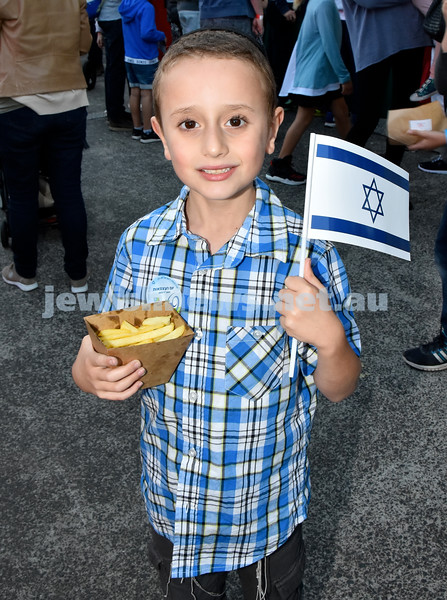 Communal Yom Haatzmaut function at Moriah College. Avishai Kessel with a box of hot chips. Pic Noel Kessel