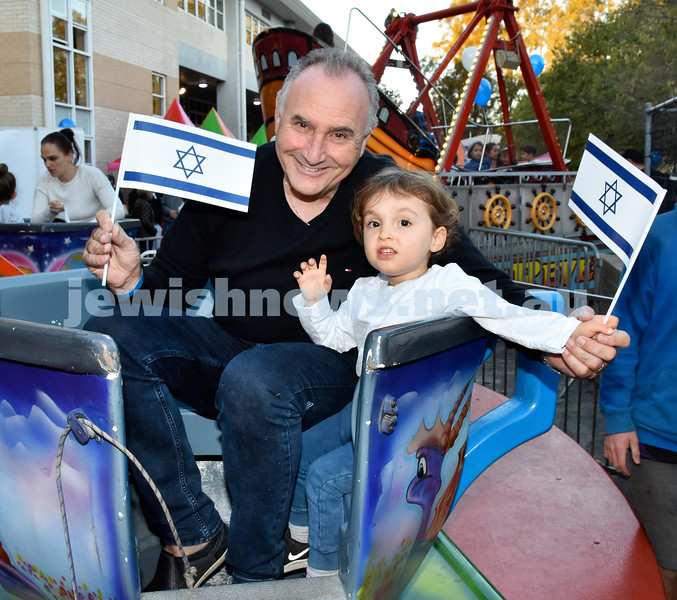 Communal Yom Haatzmaut function at Moriah College. Joe and Dion Staub on a ride. Pic Noel Kessel