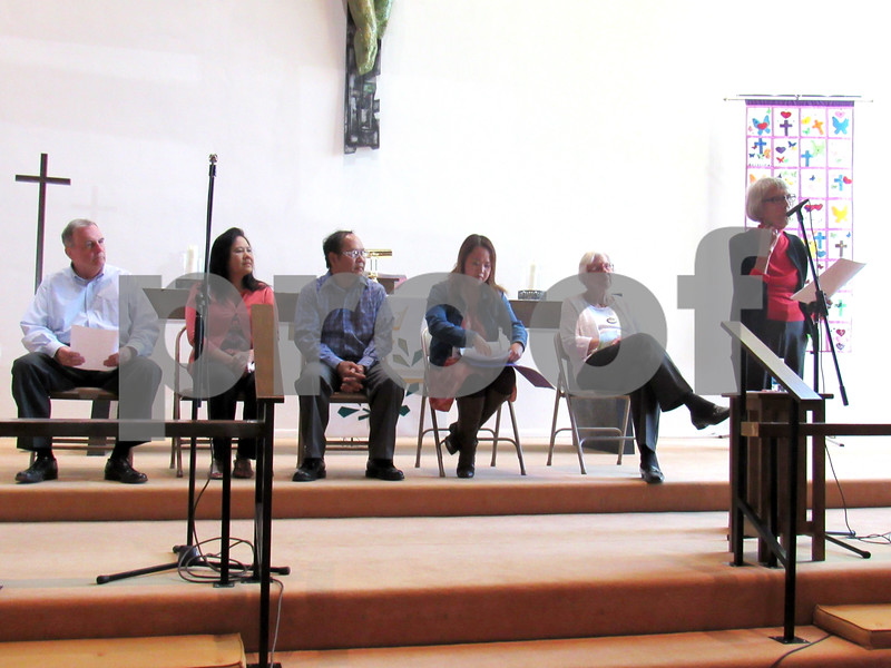 Geoffrey Wright for Shaw Media<br /> Longtime Bethlehem Lutheran Church member Anna Fischer (far right) addresses the audience Sunday afternoon at the church. Hem Lach (third from left) and his family, including his wife, Doeun (second from left), and daughter, Chandy Tracy (third from right), shared the story of how they fled Communist Cambodia in 1979. The family lived with former Bethlehem Lutheran member Dorothy Rossing (second from right) a couple of months before settling into an apartment, and Tom Imboden (far left) gave Hem his first job in American at Inboden's Meat Market.