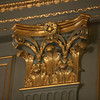 Much of the property's interior is adorned with ornate trim.  Shown here is a gold foil corbel in the main dining room