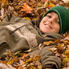 November 6, 2009<br /> <br />  Number two grandson Johnny was relaxing in the leaves  after helping with the raking this past weekend... John will be 13 years old next week.